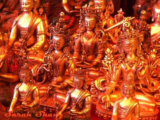 Statues of the Buddha and Tara are for sale in a Tsechu Market in Bumthang, Bhutan
