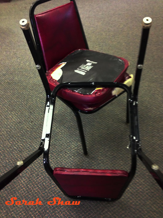 Seat removed from chair frame