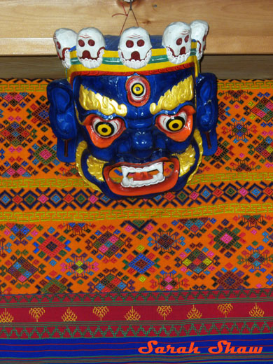 Woven fabric with mask in a Trashigang store in Bhutan