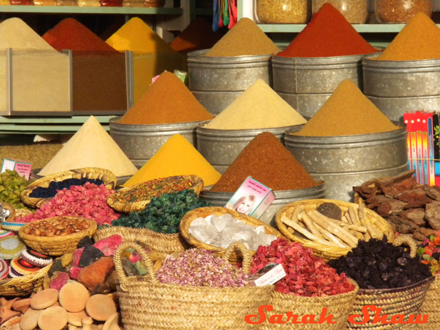 Colorful mounds of herbs and spices at a market in Marrakech, Morocco