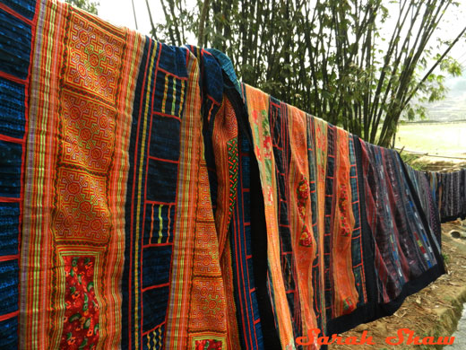 Hmong quilts line a path in Sapa, Vietnam