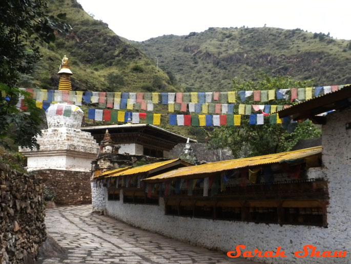 Prayer wheels and flags at Mongar Dzong