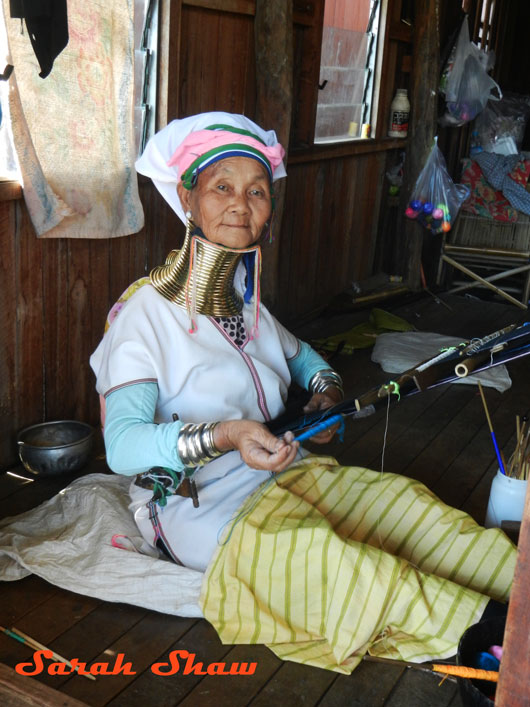 Padaung woman back strap loom Inle Lake Myanmar