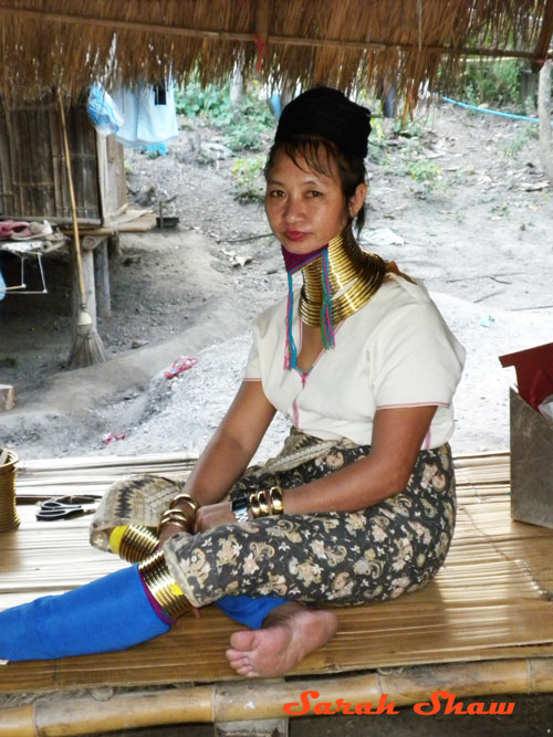 Padaung woman rings neck legs near Chiang Rai Thailand
