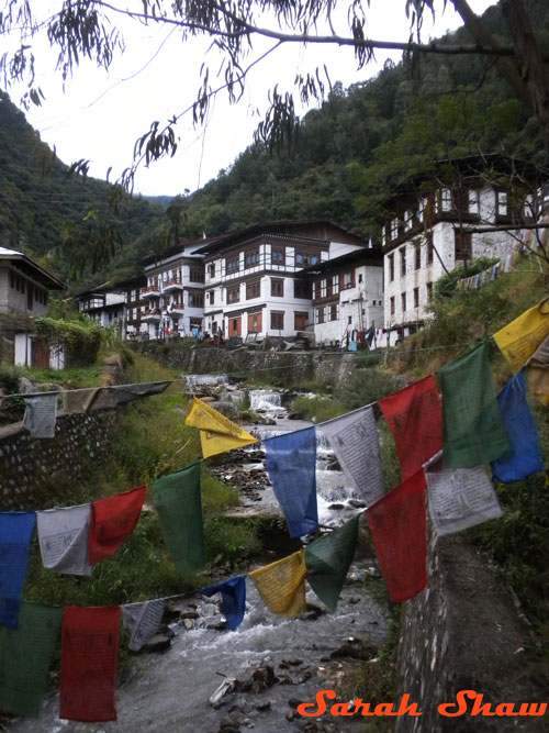 Prayer flags over a river in Trashigang
