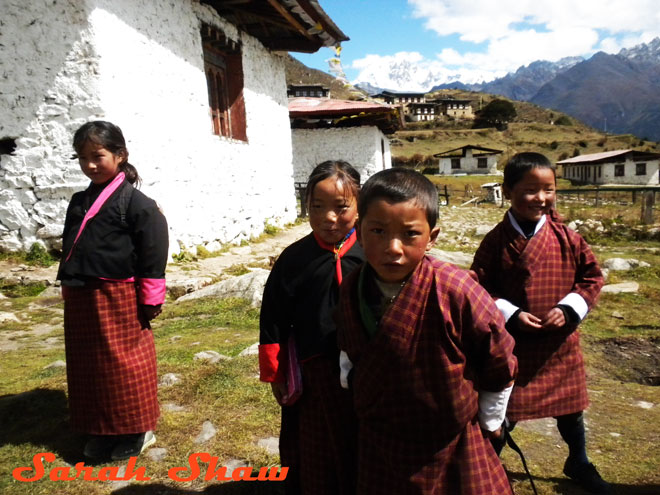 Children at school wearing the national dress of Bhutan