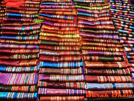 Silk scarves in brillant colors in the Night Market in Luang Prabang, Laos