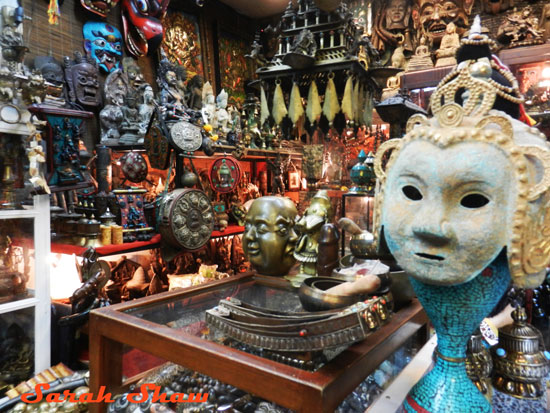 Treasures from Tibet are offered in the stall at the Chatuchak Weekend Market in Bangkok, Thailand