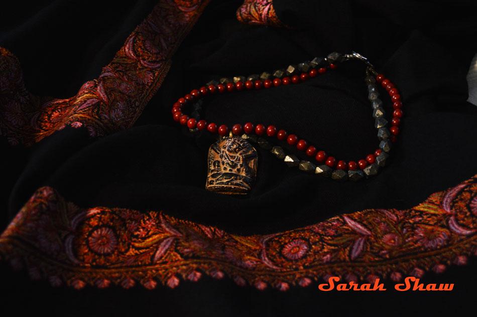 Amulet necklace on pashmina