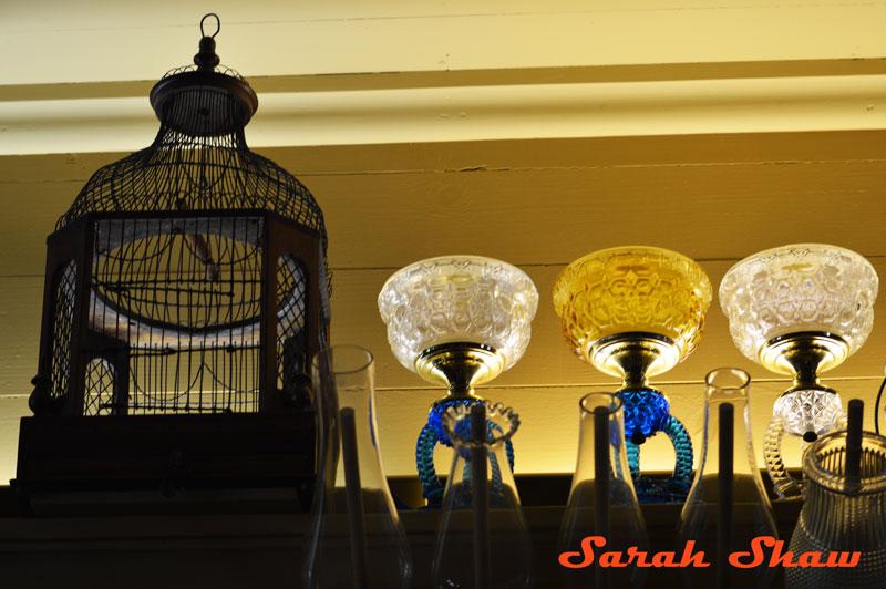 Birdcage with kerosene lamps