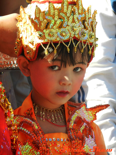 A young initiate outside a temple in Burma