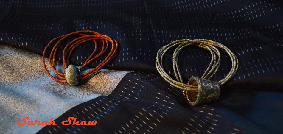 Roman glass necklaces on indigo silk