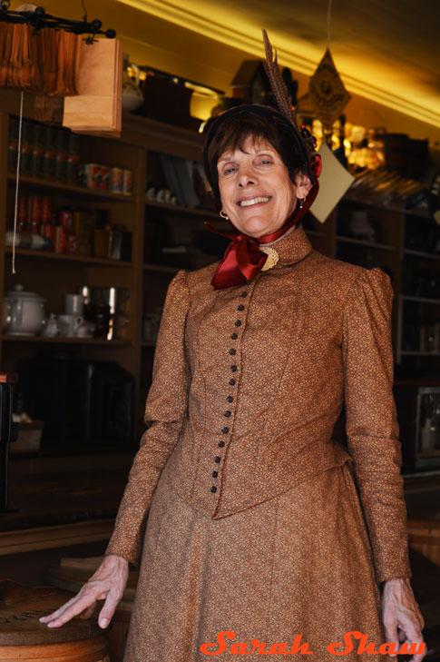 Shopkeeper in period dress