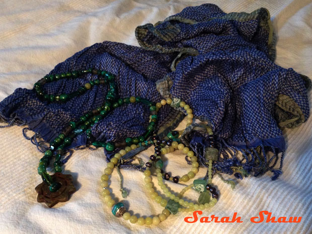 Silk scarf with necklaces
