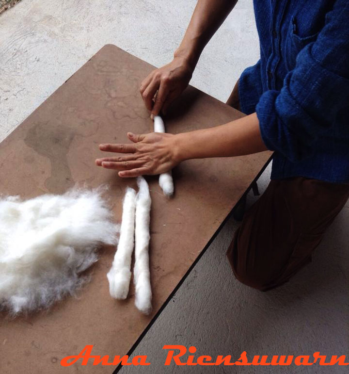 Preparing cotton for spinning in Thailand