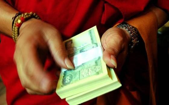 Monk with money