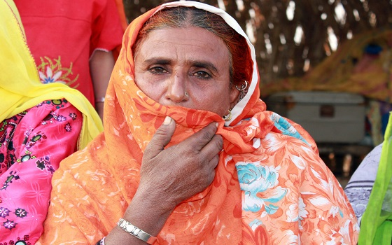 "Nekbakhat, aged 50, had to flee her home with her husband and five children in the middle of the night when the flood came in August 2010.  ""Before the flood I was happy here. The water came in the middle of the night. It was difficult to escape in the dark. We were holding onto each other and crying.""  ""It is good now that we have clean water here again. Since we came back we had to go to the next village to get water, so now it is a little easier. The hygiene training has also been good, and it means that now there is no disease in the village"". ""The problem now is that we cannot grow rice or wheat to eat, not even fodder for the animals"".  Nekbakhat's village is one of hundreds that are being helped to recover from the disaster by the NGO Mercy Corps, with the support of funding from the British government's Department for International Development.Mercy Corps have installed clean water pumps and basic sanitation in the village, to help meet people's basic needs as they return home after the flood waters subside."