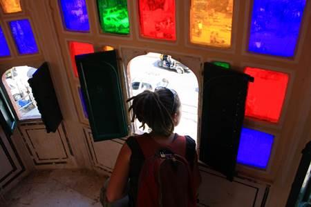 Tourist Looking Through Hawa Mahal Window