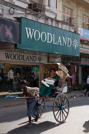 Woman Riding Rickshaw in India