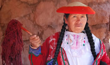 woman with dyed wool in peru