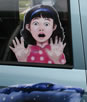 cartoon kid in car