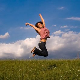 Woman Jumping in Field
