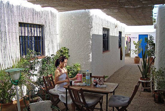 Woman Eating Breakfast At a Hostel