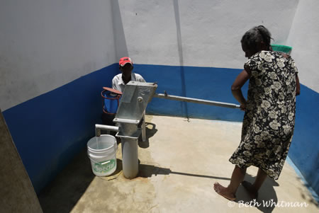 Woman at water Well in Haiti