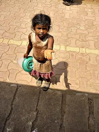 Beggar Girl in India