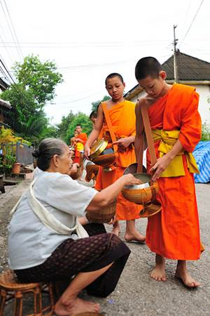 Lao Elderly Lady Giving Alms to Monks