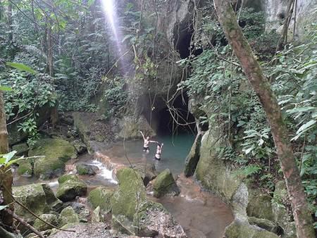 Swimming at Actun Tunichil Muknal