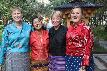 women in kiras in bhutan