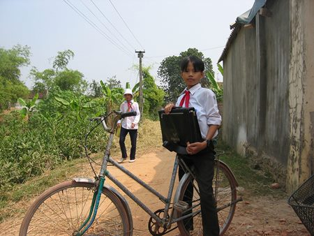Vietnamese Schoolchild on Bike