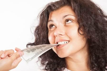 Girl Biting Money