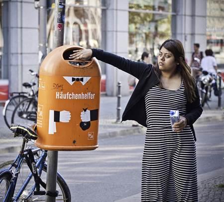 Woman Throwing Trash